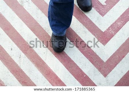 man walking on traffic sign - stock photo
