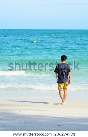 man walking  on tropical beach