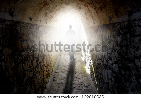 Man walking to the light - stock photo