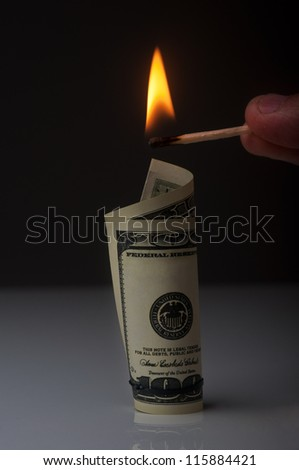 man want to burn dollar bill
