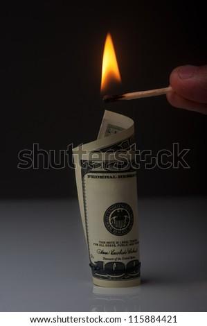man want to burn dollar bill - stock photo