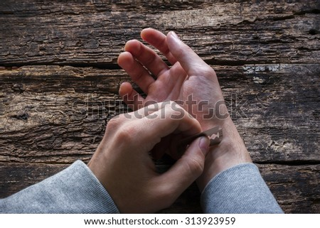 man wants to commit suicide by cutting his veins - stock photo