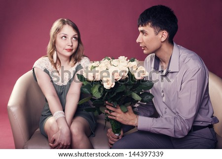 Man wants to give a bouquet for his girlfriend - stock photo