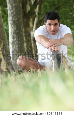 Man warming up before jog - stock photo