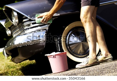 man washing antique car - stock photo
