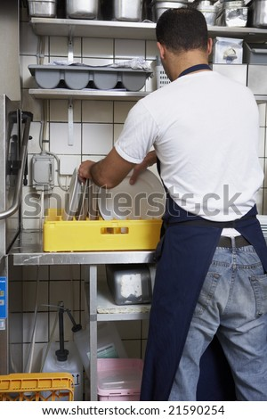 man washing dishes - stock photo