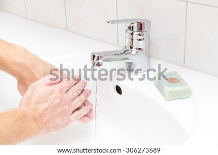 Man washing hands with soap - stock photo