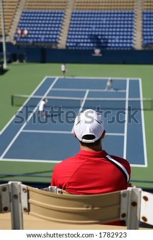 Man watching a tennis match - stock photo