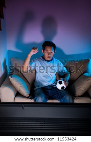 Man watching live football on television