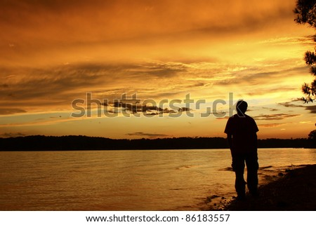 man watching the sunset