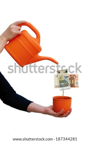 man watering flower cash - stock photo