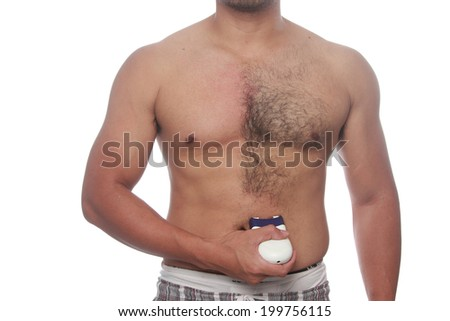 man waxing his breast to depilate hair  - stock photo