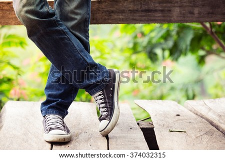 Man wear jeans and sneakers on outdoor/park