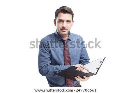 Man wearing a blue shirt and red tie. He is holding a black folder. Over white background - stock photo
