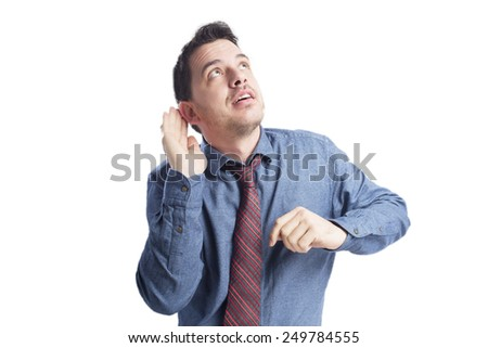 Man wearing a blue shirt and red tie. He is paying attention.Over white background - stock photo