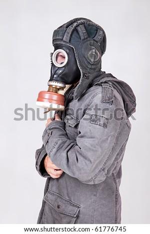 man wearing a gas mask - stock photo
