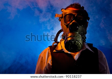 Man wearing a gas mask for protection against pollution - stock photo