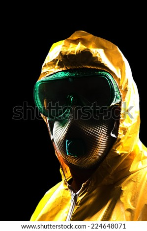 Man wearing a hazmat suit in the face of infectious disease - stock photo