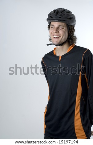 Man wearing a helmet smiles. Vertically framed photograph - stock photo