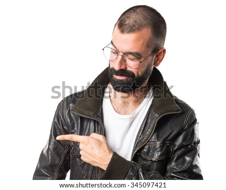 Man wearing a leather jacket pointing to the lateral
