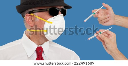 Man wearing a mask being vaccinated  - stock photo