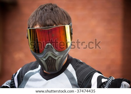 man wearing a paintball mask - stock photo