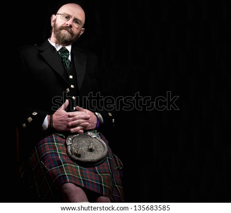 Man wearing a scottish kilt - stock photo
