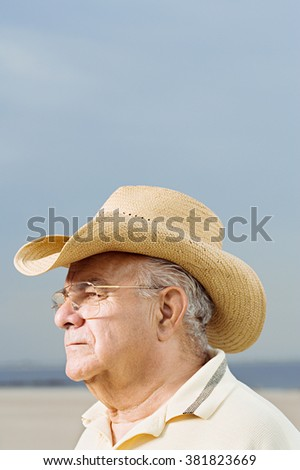 Man wearing a straw cowboy hat - stock photo
