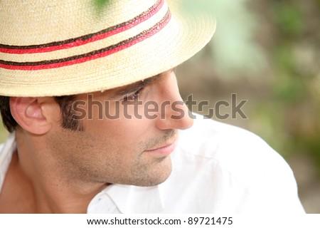 Man wearing a straw hat - stock photo