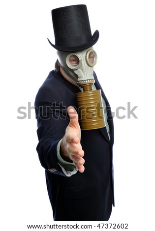 Man wearing a suit and gas mask on a white background - stock photo