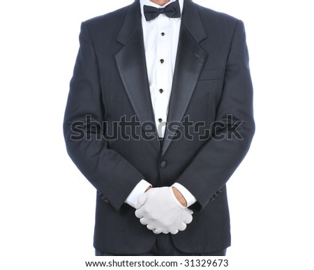 Man Wearing a Tuxedo with His Hands in Front of Body - Torso only isolated on white - stock photo