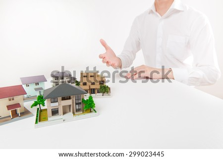 Man wearing a white shirt that are designing a house - stock photo