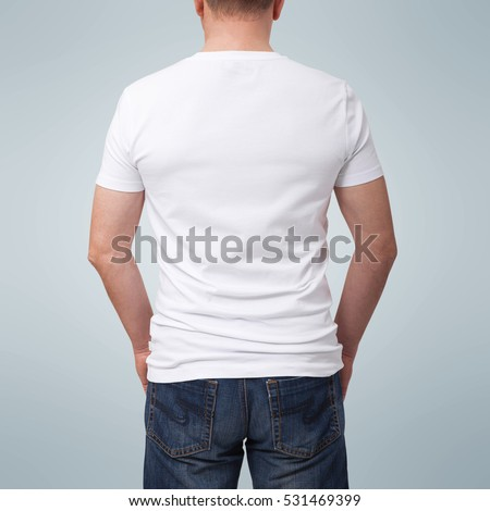 Man wearing blank t-shirt isolated on gray background with copy space. Tshirt design and people concept - close up of man in blank white t-shirt isolated. For mock up template design. Back view