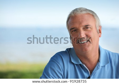 Man wearing blue polo - stock photo