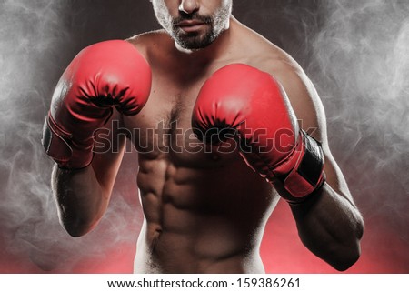 man wearing boxing gloves - stock photo