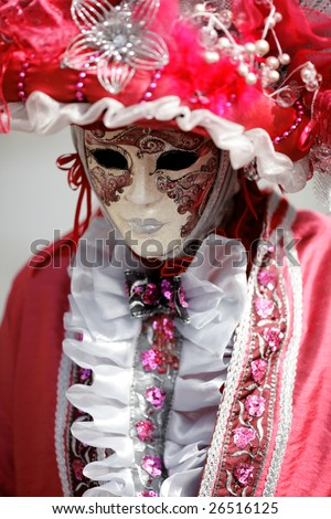 Man wearing carnival mask under pink and white rustle (Annecy/France) - stock photo