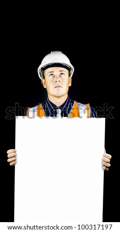 Man wearing construction helmet and holding blank white board