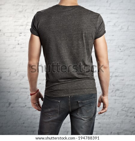 Man wearing dark grey t-shirt. Back - stock photo