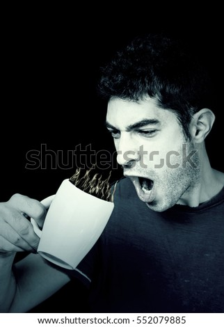 Man wearing drinking coffee for breakfast, hot drink