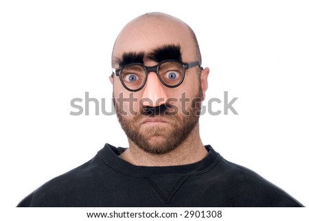 Man wearing fake nose and glasses with mustashe and eyebrows over a white background - stock photo