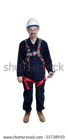 Man wearing fall protection harness and lanyard - stock photo