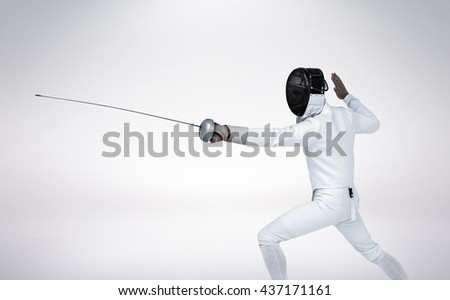 Man wearing fencing suit practicing with sword against grey vignette