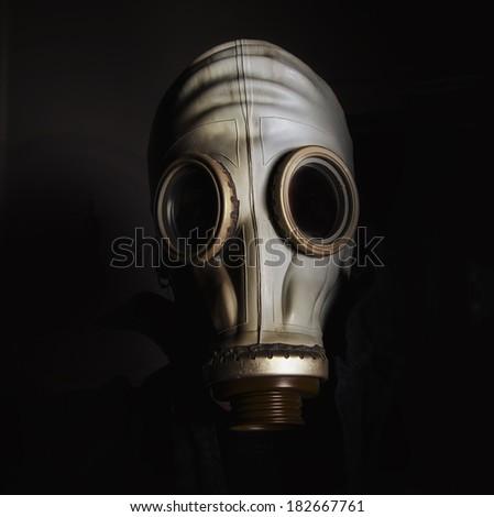 Man wearing gas mask  - stock photo