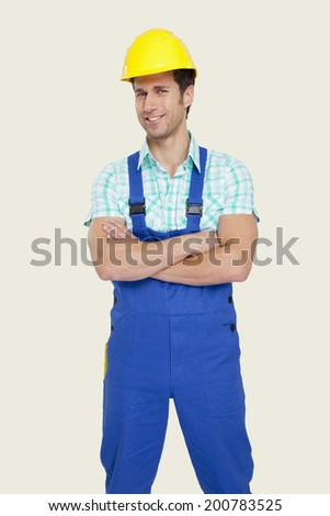 Man wearing hard hat arms crossed smiling