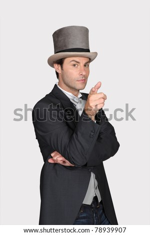 Man wearing hat and tailcoat - stock photo