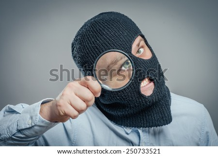 Man Wearing Mask and magnifier - stock photo