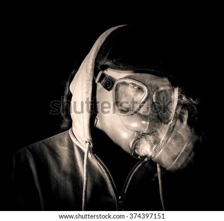 Man wearing mask and smoking,low key and sepia  - stock photo