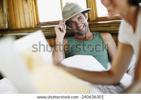 Man Wearing Pith Helmet in Bed - stock photo