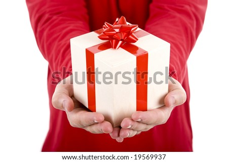 man wearing red shirt holding a christmas gift box - stock photo