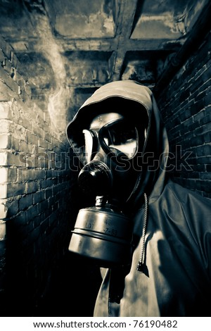 Man wearing respirator or gas mask - stock photo
